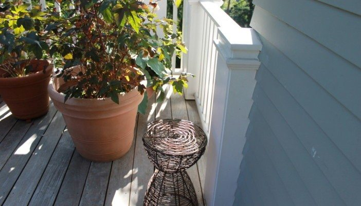 Wood deck over waterproof membrane